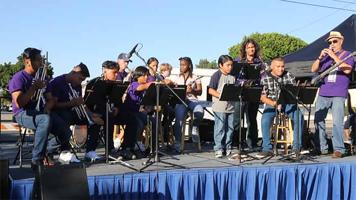 Barry Cogert with students from Paramount School District and mentors performing for the Paramount Elks.